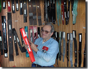 Picture of Jim holding mower blades